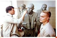 "Frederick Hart working on clay modele for ""Three Servicemen"" at Vietnam Veterans Memorial"