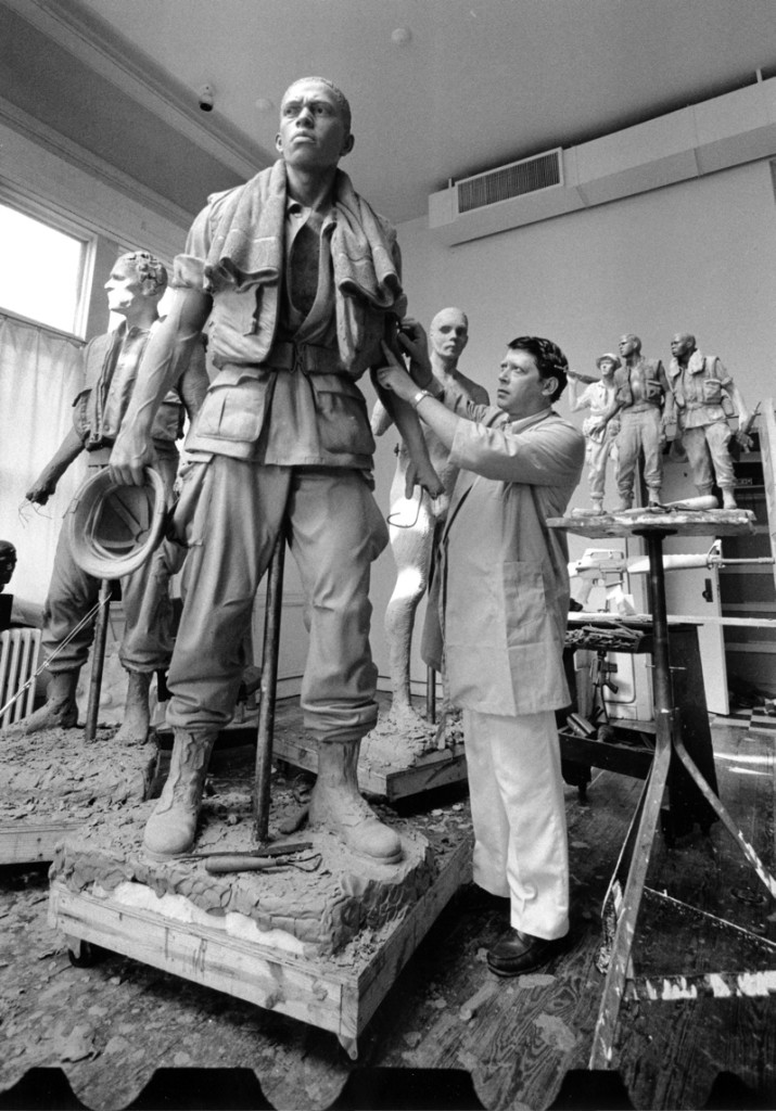 "Frederick Hart working on clay modele for ""Three Servicemen"" at Vietnam Veterans Memorial, Washington, DC"